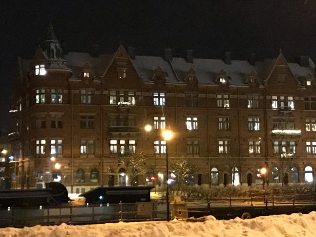 Posh Building At Winter With Cozy Lights