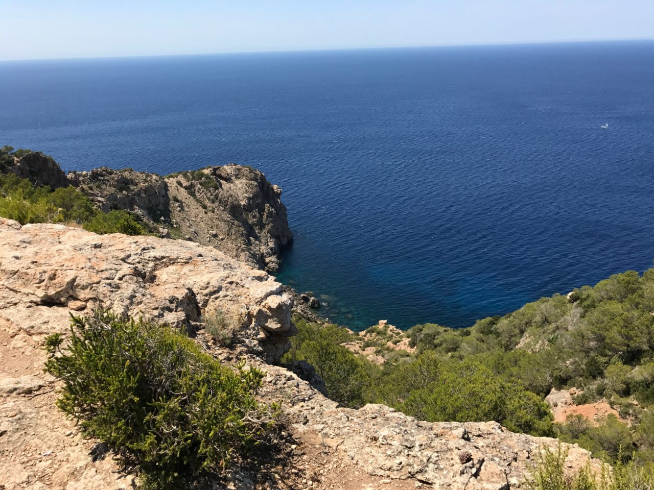 View Of An Ocean Cove From On Top Of A Cliff Side