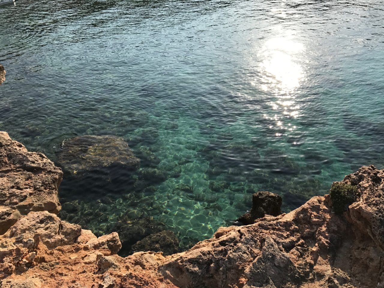 Sunlight Glare In Tropical Water Off The Coast Of Ibiza