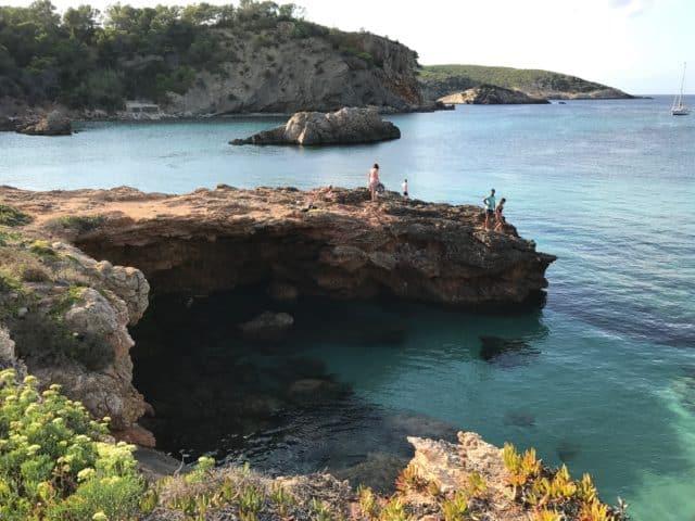 Cliff Divers Assessing The Ocean Below