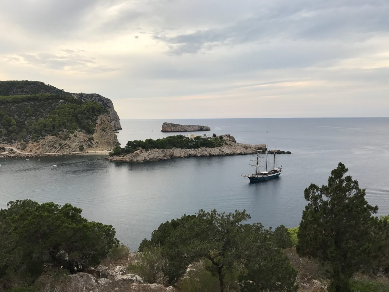 Wide View Of Sail Boat By Cliff Island In Cove