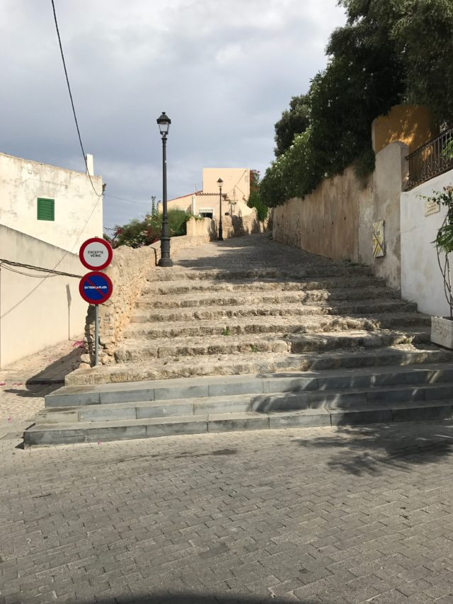 Small Town Stairs And Pathway With Street Signs