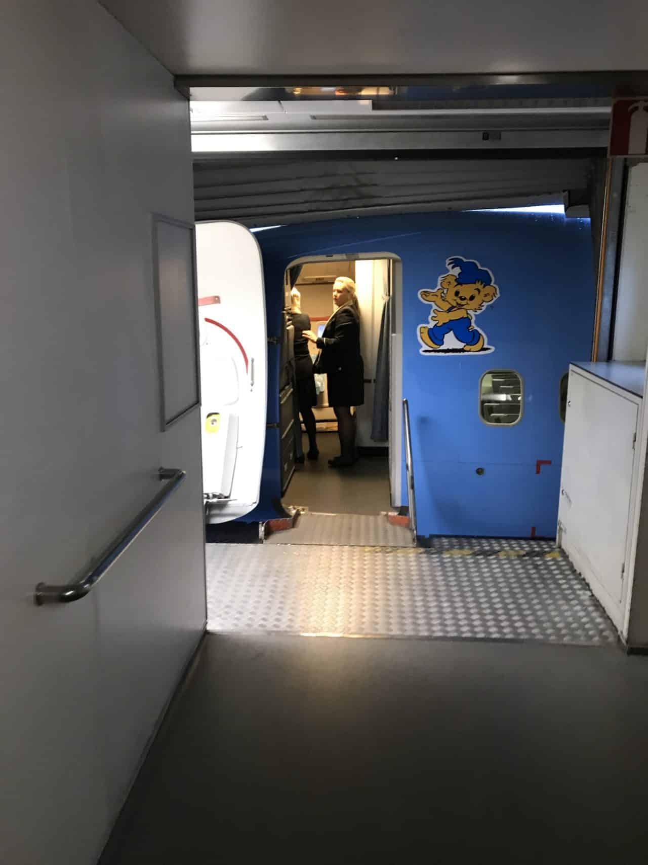 Boarding Walkway Leading To Airplane Door