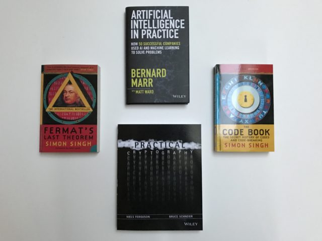 Artificial Intelligence And Cryptography Books On A Table