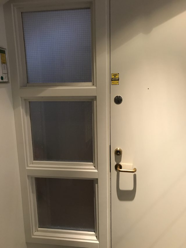Closed White Door With Frosted Fireproof Square Windows