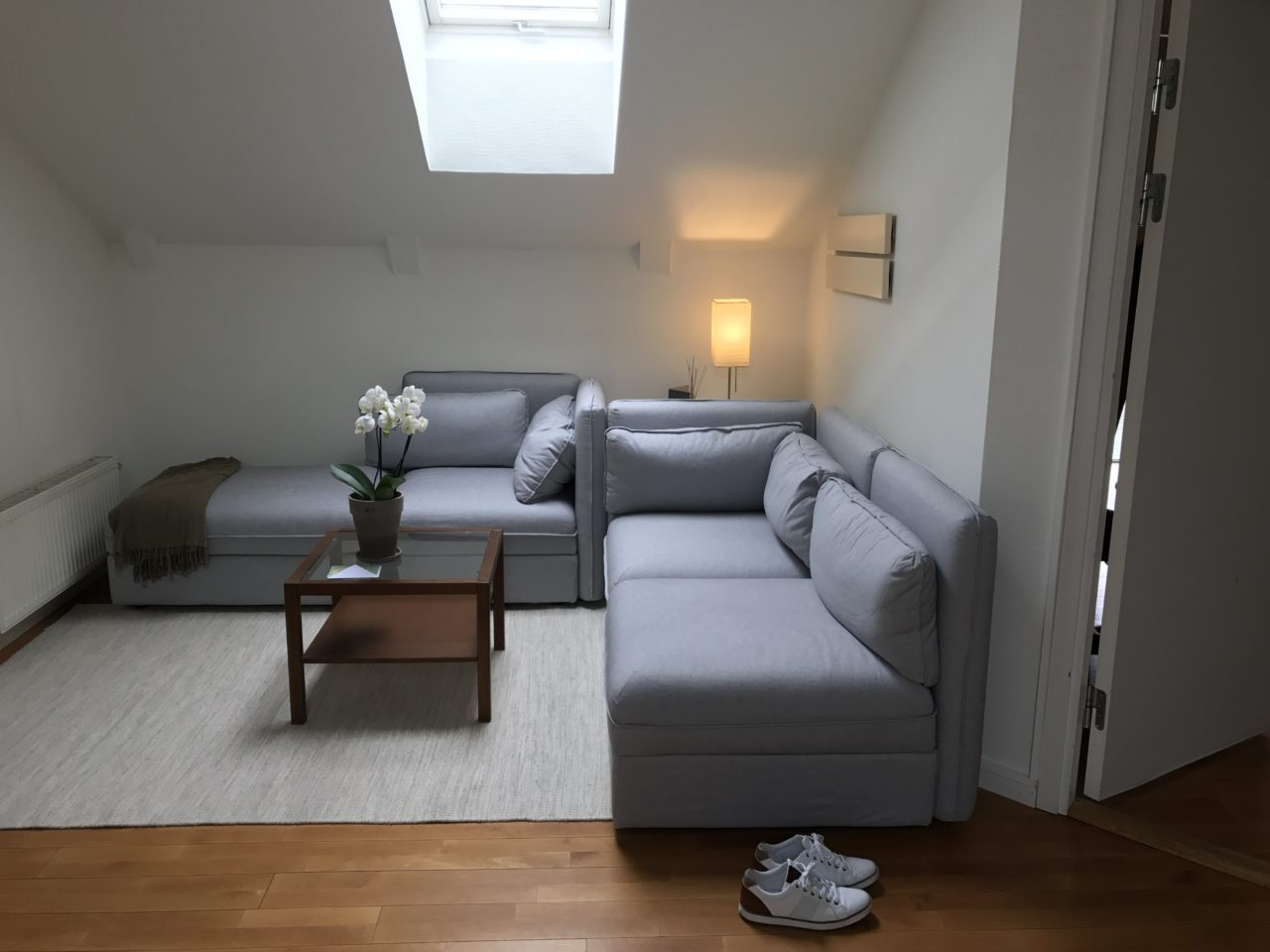 Bright Lounge With Skylight Window And Shoes On The Floor