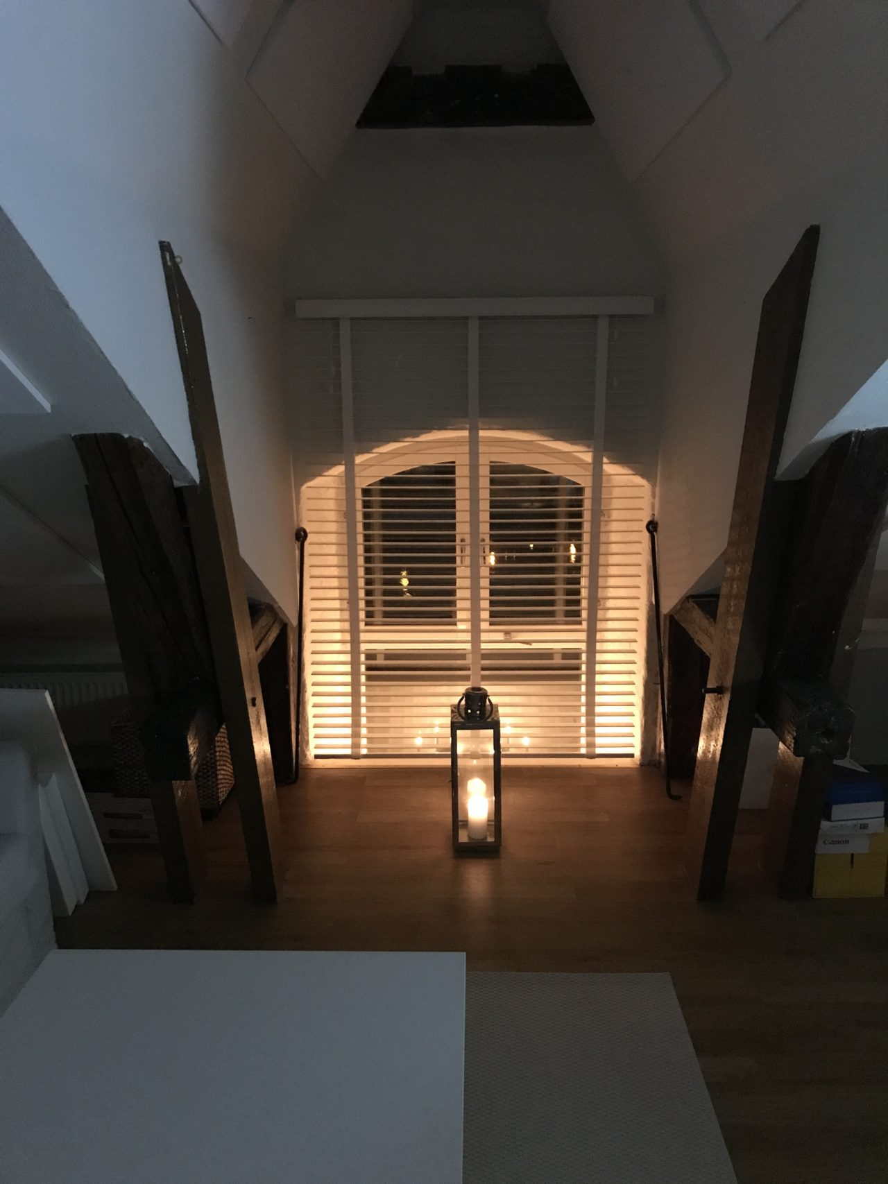 Cozy Nook With Candle Lantern By The Window