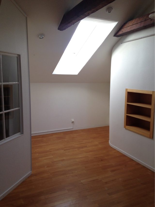 Empty Corner With Skylight Window And Bookshelf