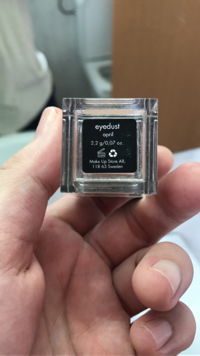 Hand Holding Eyedust Makeup Package