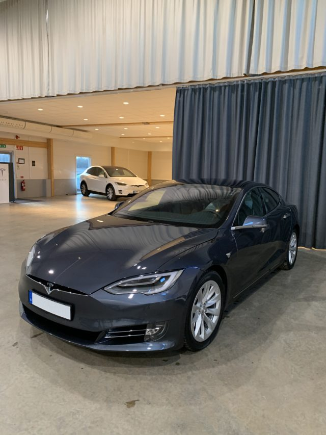Gray Tesla Model S Long Range Car In Tesla Showroom
