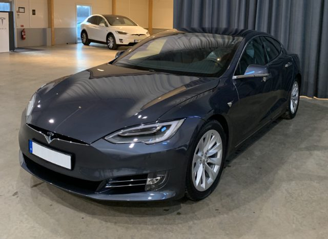 Gray Tesla Model S With A Model X In The Background In Showroom