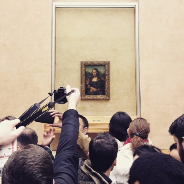 Leonardo Da Vinci's Famous Portrait Mona Lisa In The Louvre Museum In France