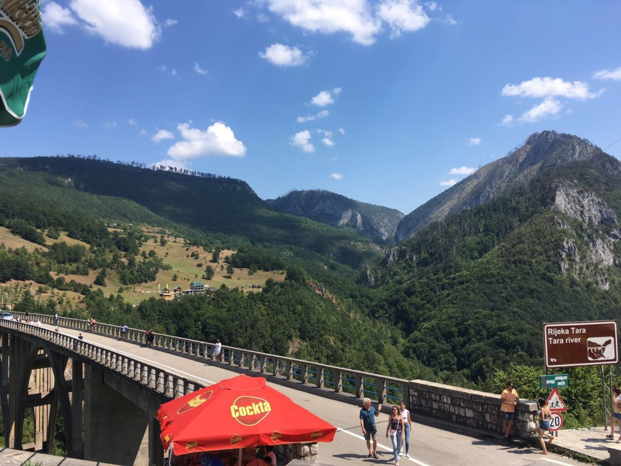 Bridge Over The River Tara In Montenegro With Mountains In The Background