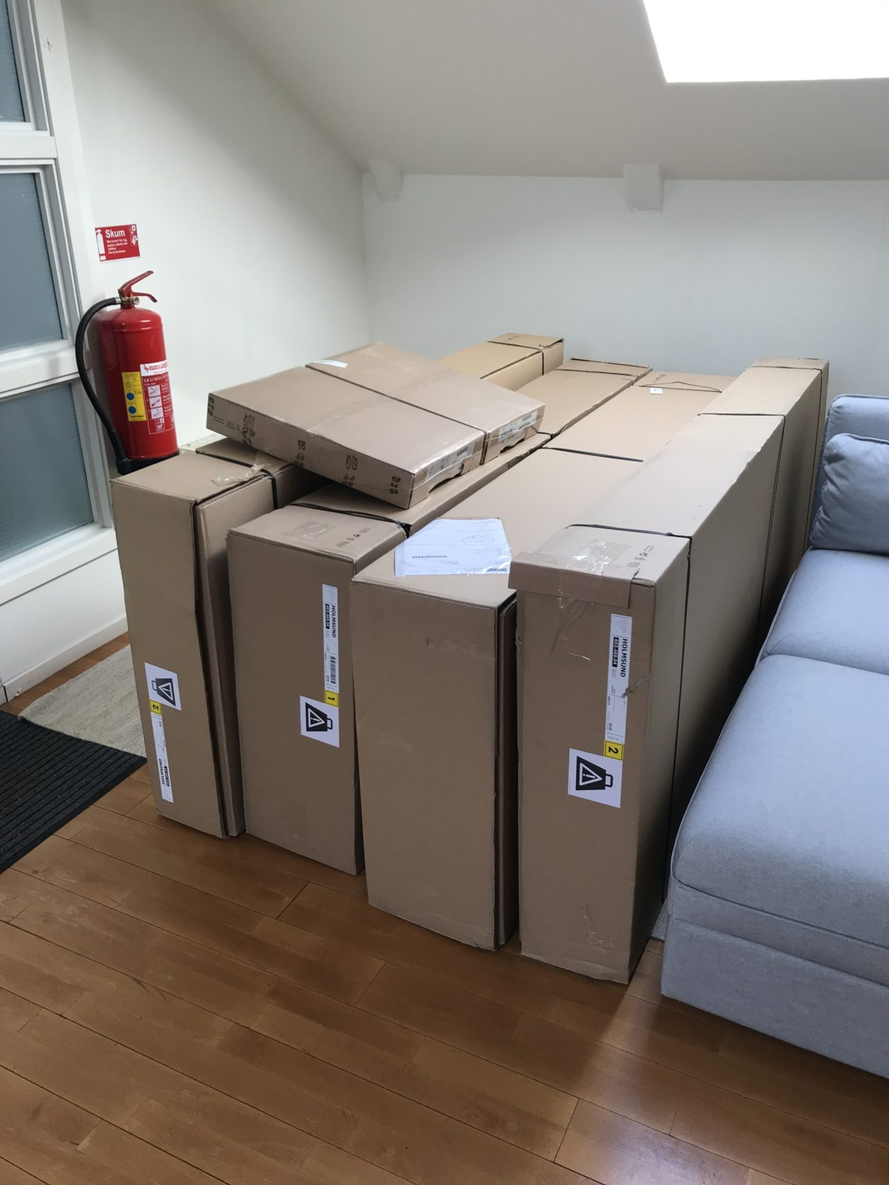 Cardboard Boxes With Furniture Lined Up Beside Each Other
