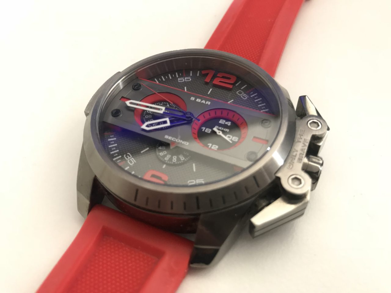 Closeup Of A Diesel Watch With A Red Wristband