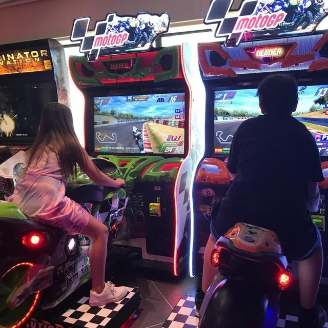 Children Compete In Motorcycle Games In Gaming Hall