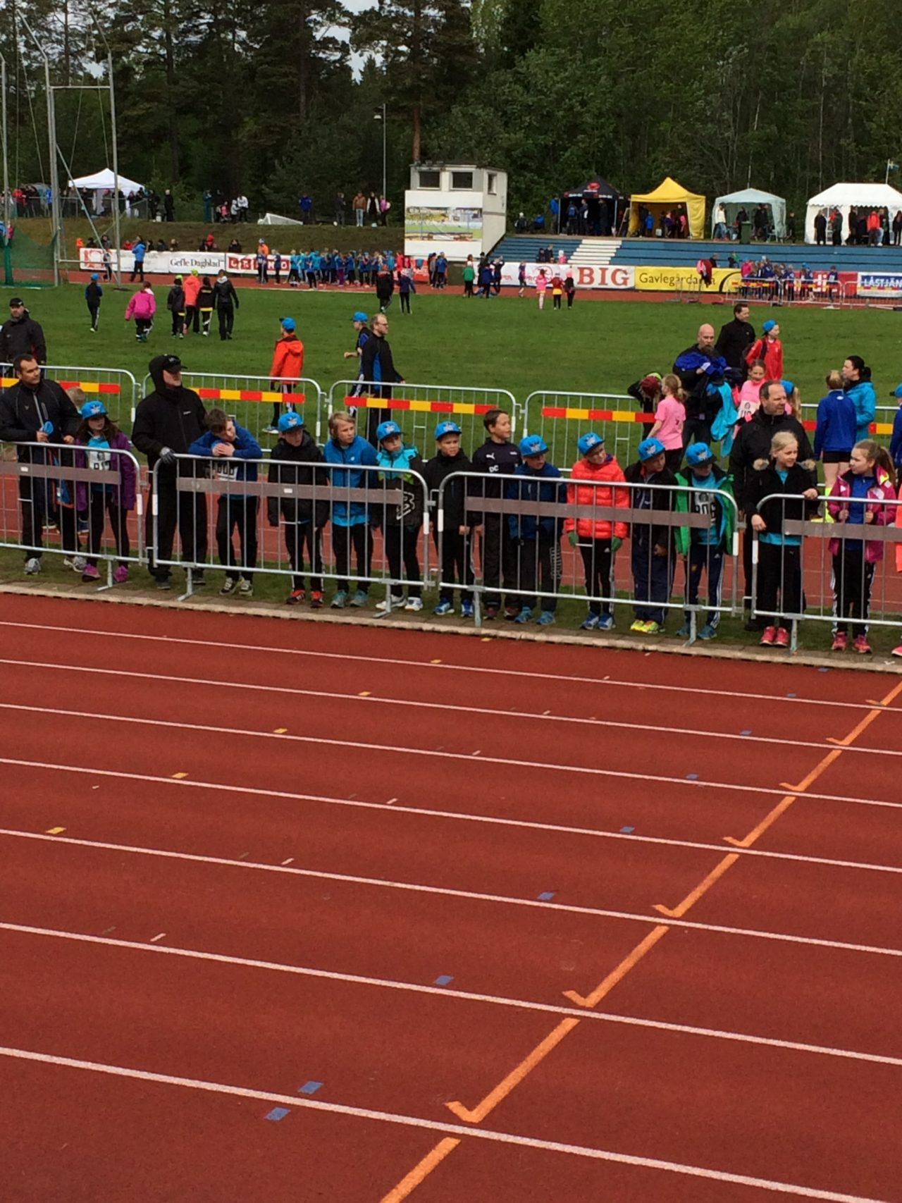 Running Competition At An Athletics Arena With An Audience On The Side
