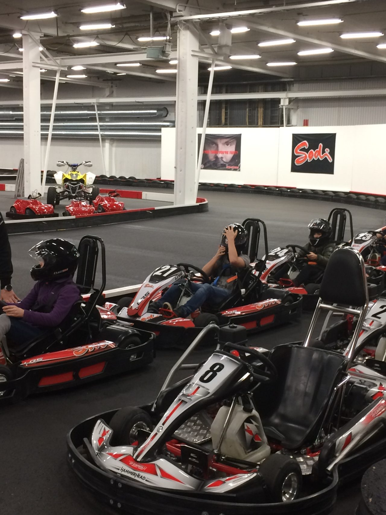 Young People Go Go-Karting On An Indoor Track