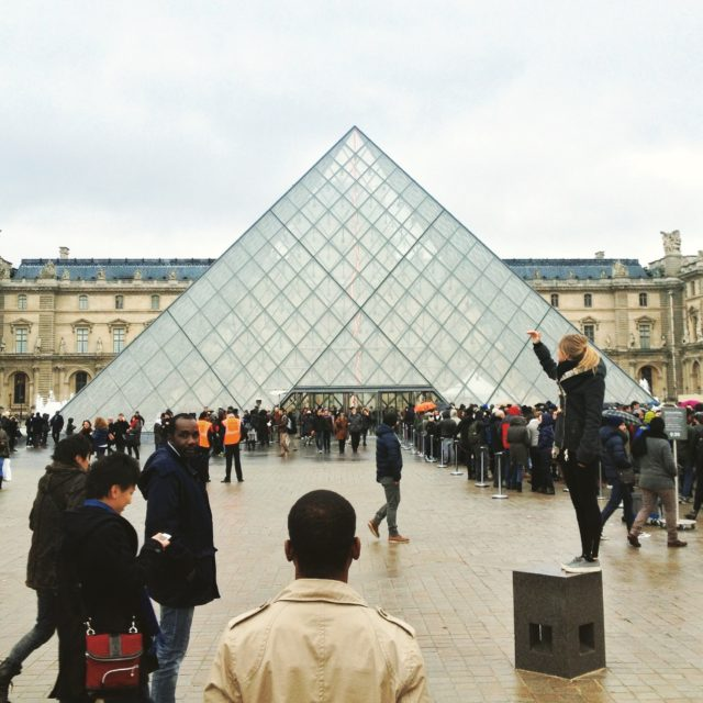 Louvre Museum Outside With People Queuing To See Its Famous Artistic Creations
