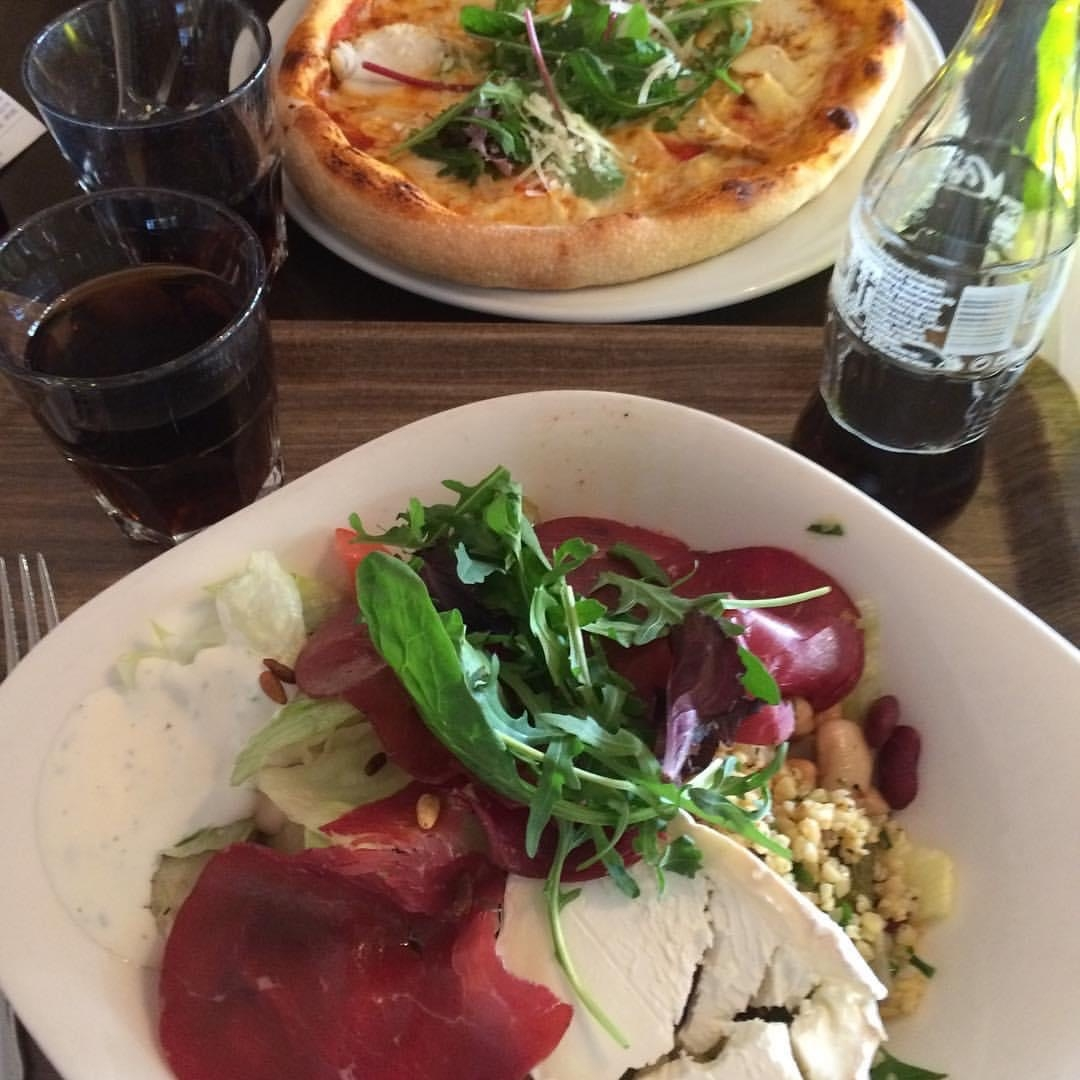 Pizza On White Plate And Salad With Goat Cheese And Coca Cola