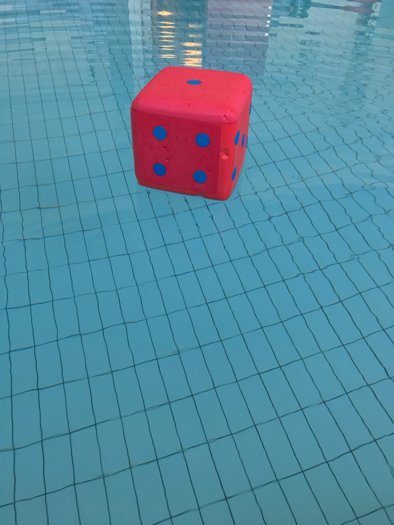 Floating Dice With Blue Dots In The Exercise Pool