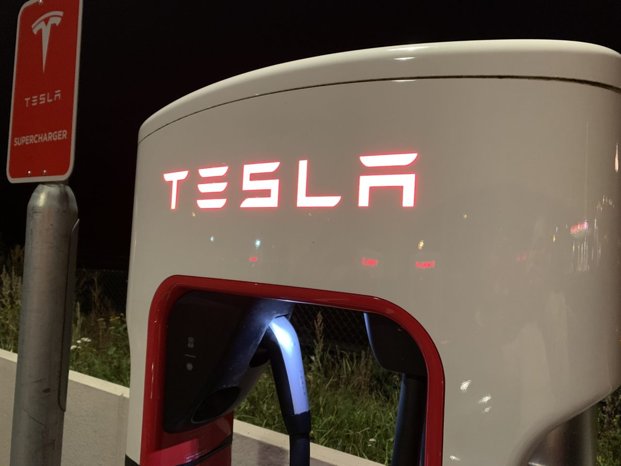 Tesla Supercharger Station Stall Glowing Logo