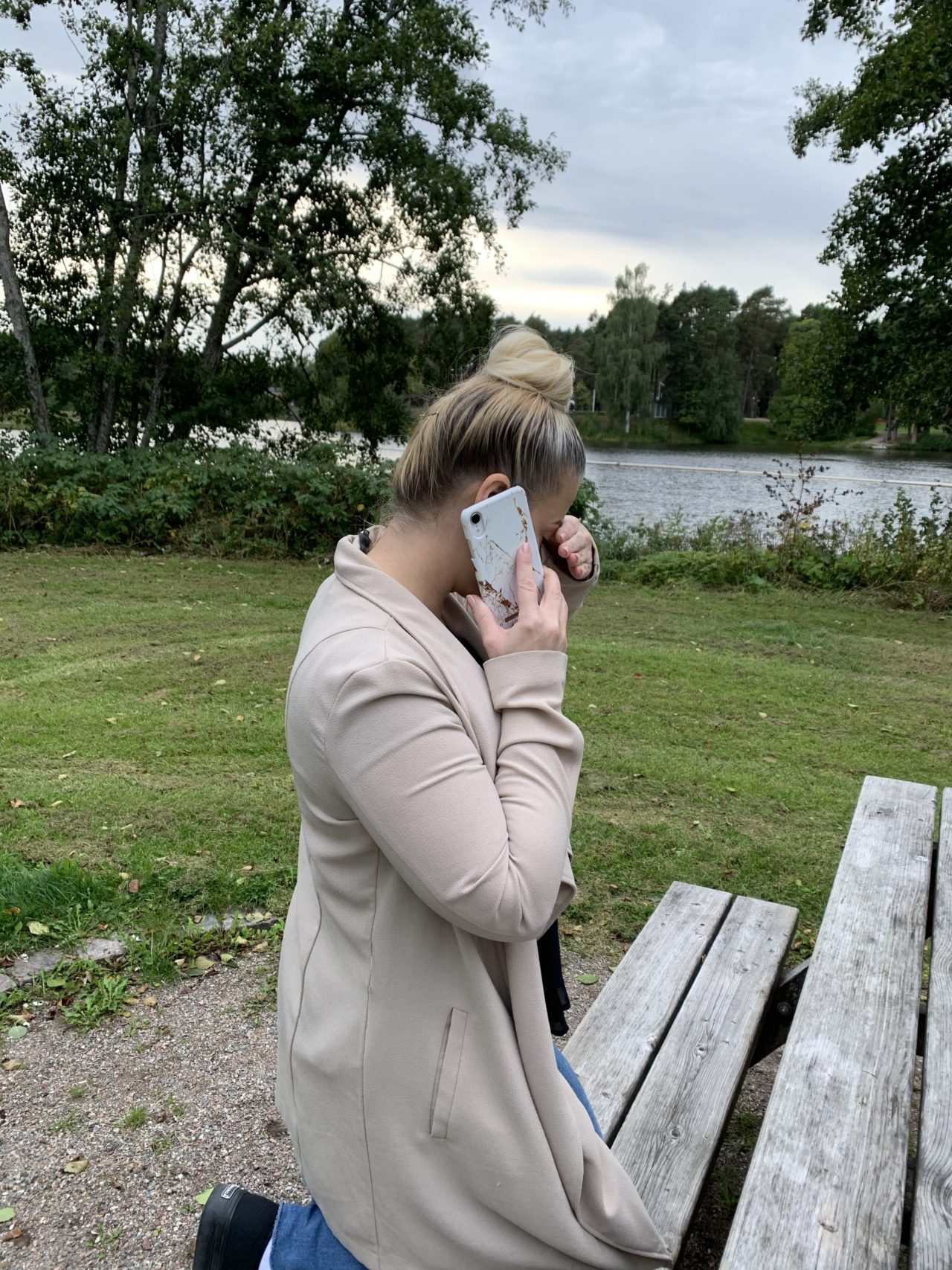 Woman With Her Hand Over Her Face Talking On Phone