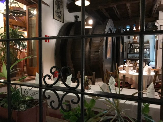 Looking Through Window Into Restaurant With Beer Barrels And Tables