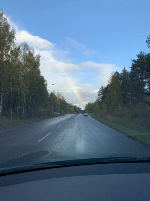Driving Car After Rain With A Rainbow