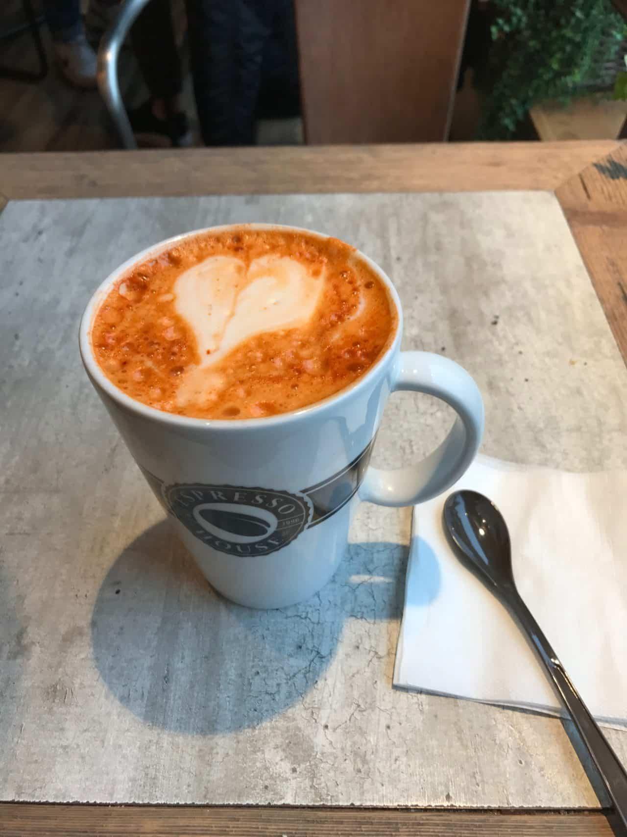 Coffee Latte In A Mug With A Heart In The Foam