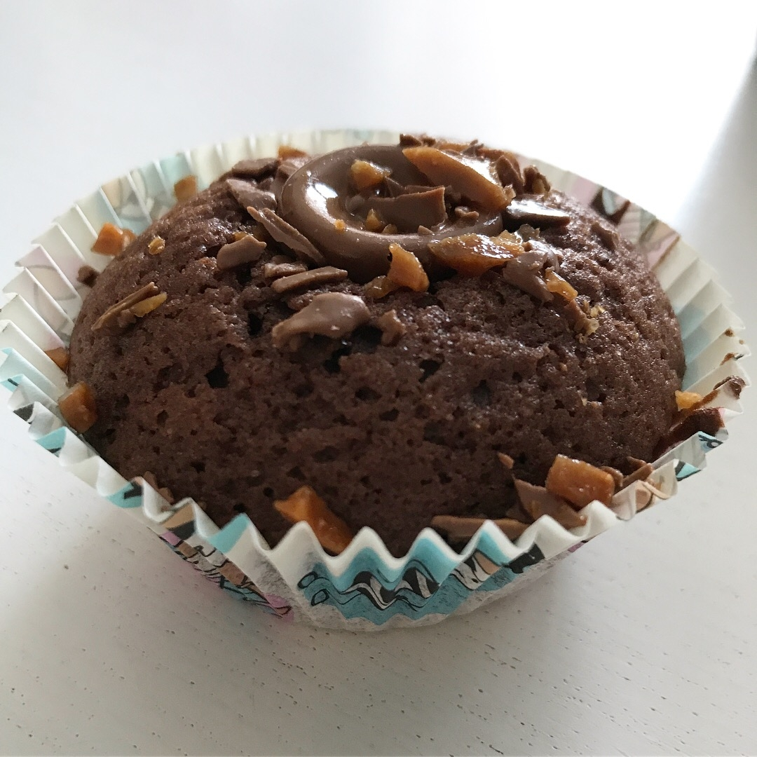 Chocolate And Caramel Muffin In Paper Wrapping