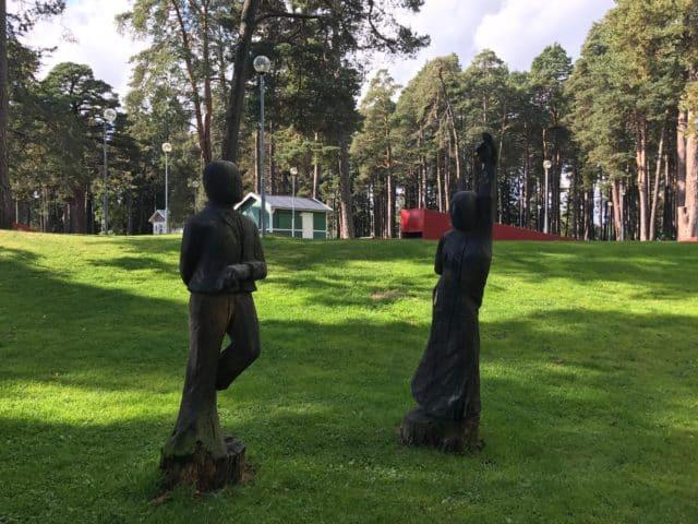 Dancing Wooden Tree Sculptures In A Park