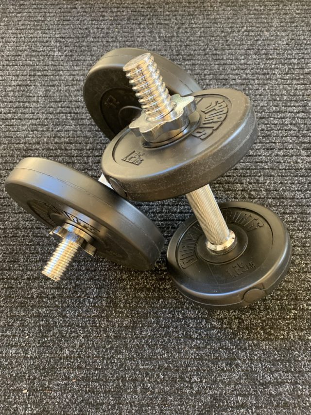 Workout Equipment Weight Dumbbells On Gym Floor