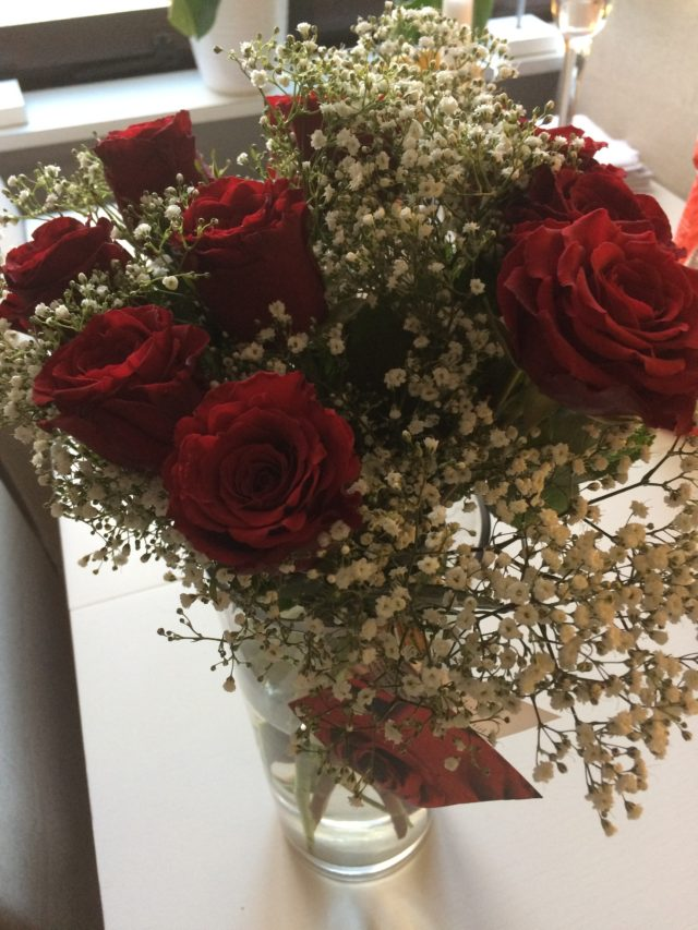 Bouquet Of Red Roes In A Vase On A Table