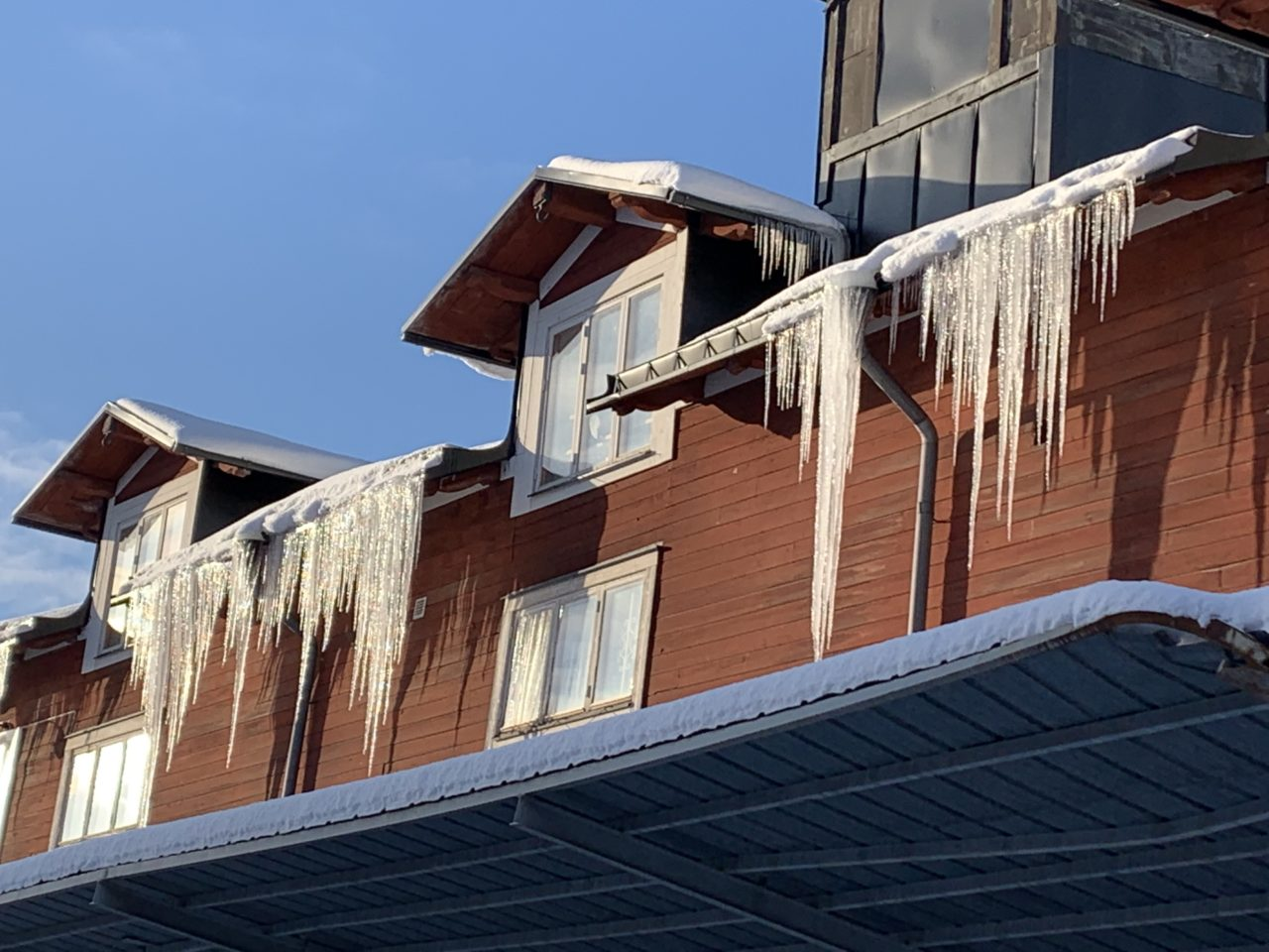 Icicles Hanging From A Winter Roof