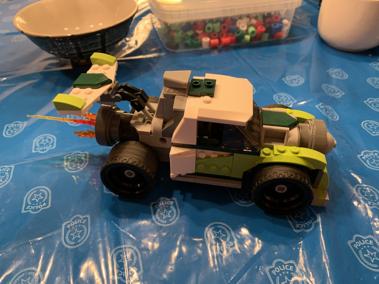Lego Car Build On A Table In A Kid's Room