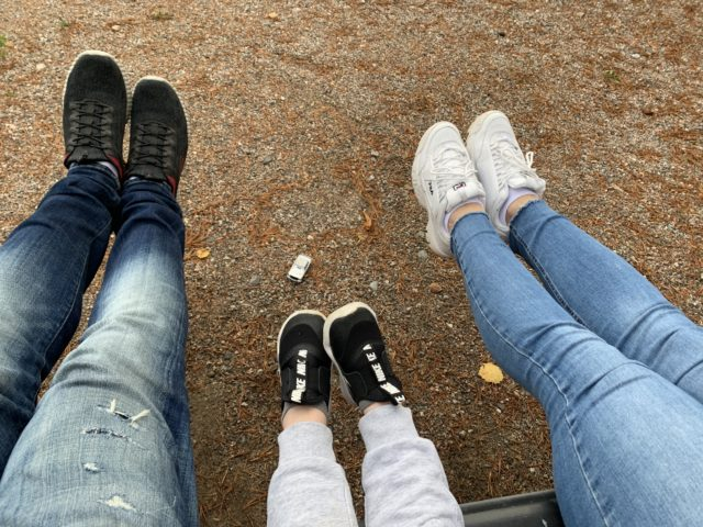 Lifted Family Shoes Sitting On A Bench