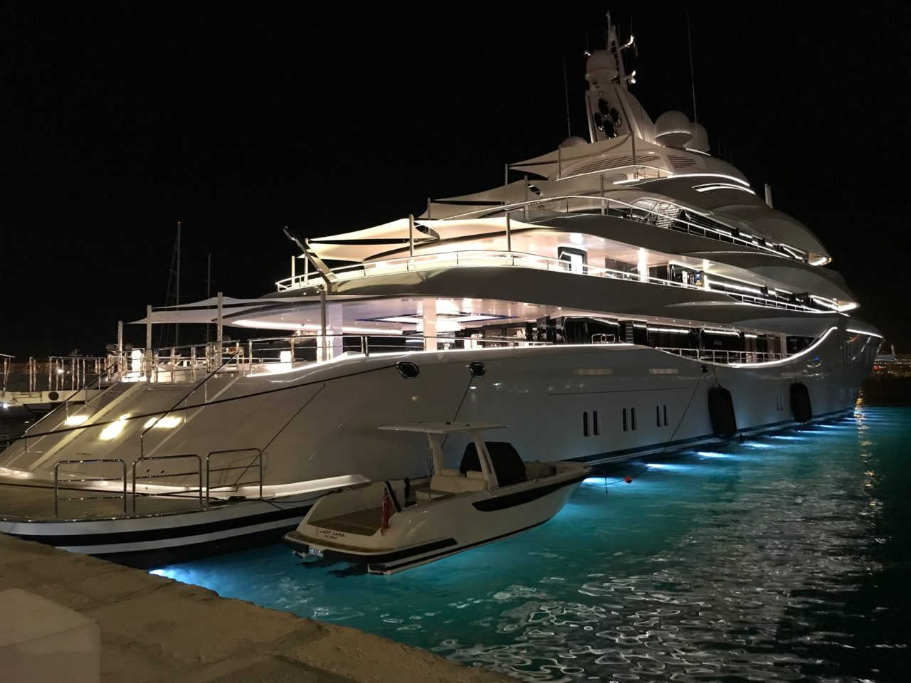 Luxury Yacht At The Dock In Ibiza City At Night