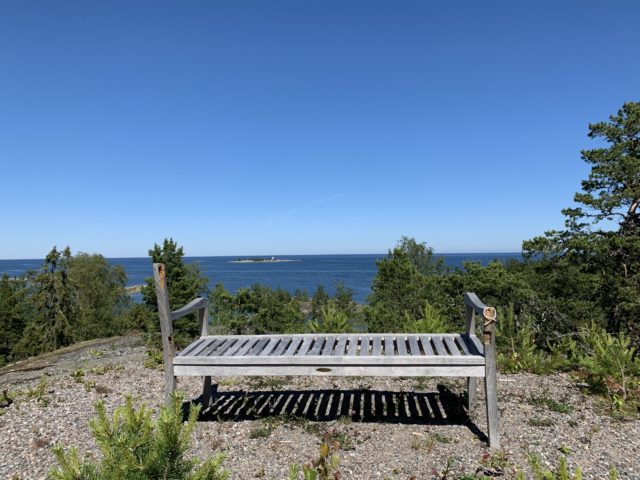 Old Broken Wooden Bench On A Mountain Top With A Ocean View