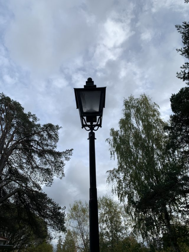Black Old Lamp Post In The Evening