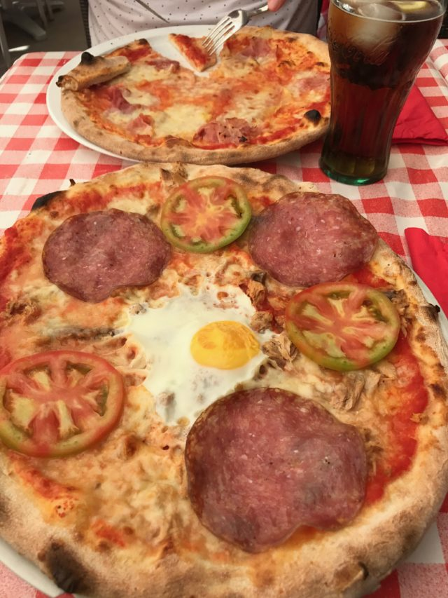 Pepperoni Pizza With Tomato And A Coke