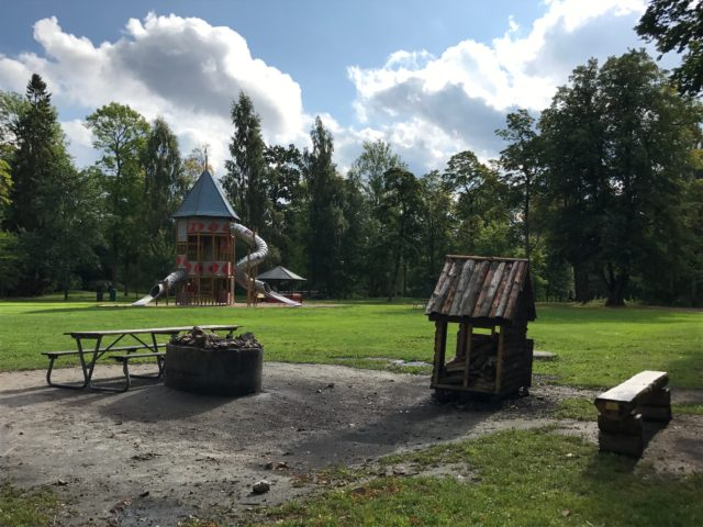 Playground With A Park Bench And Fireplace