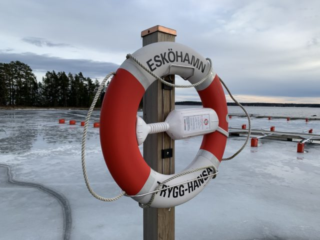 Lifebuoy Mounted At A Harbour In The Winter