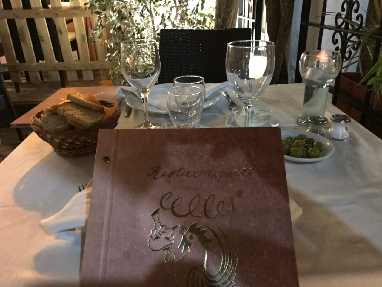 Restaurant Table With Menu And Glasses