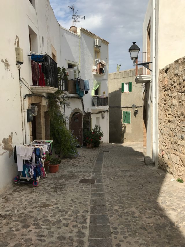 Picturesque Street With Laundry In Ibiza In Spain