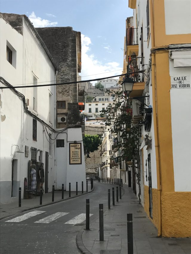 Narrow Street Alley With Sidewalk In Spain