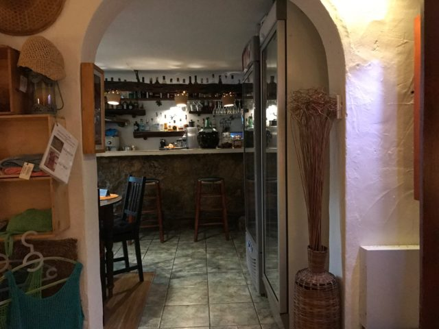 Small Spanish Bar With Bottles And Bar Stools