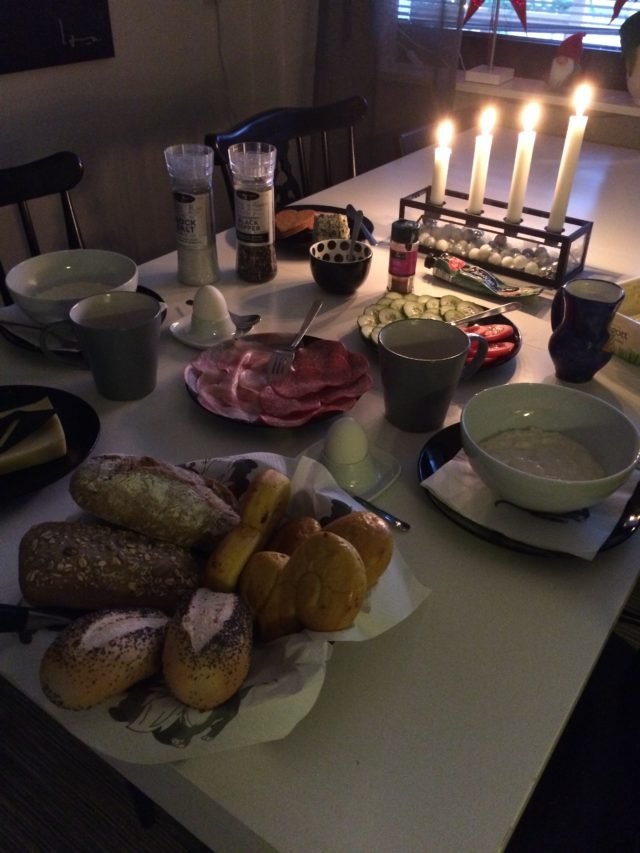 Swedish Christmas Breakfast With Bread Rice Porridge And Lit Candles