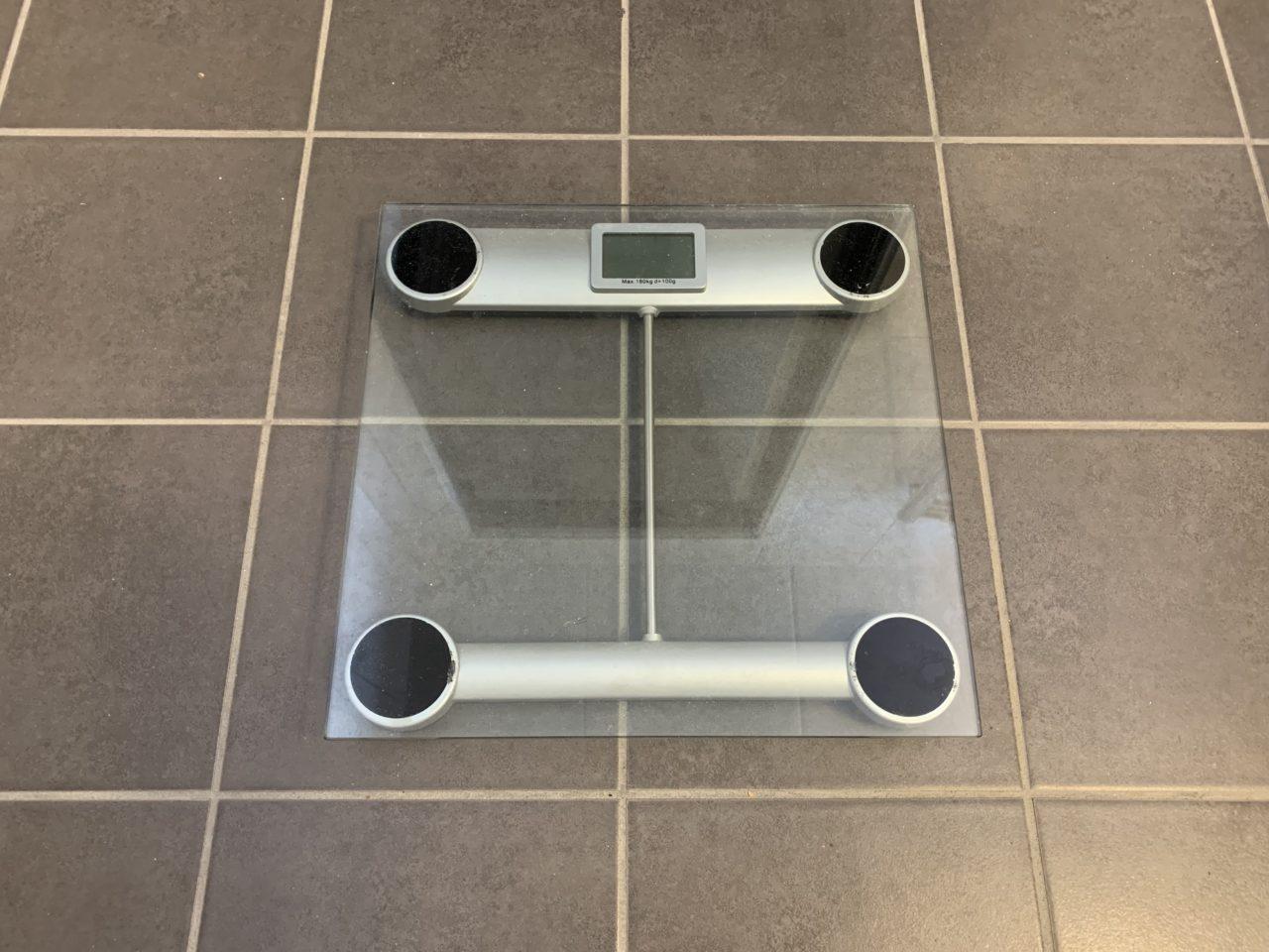 Glass Weight Scale On Bathroom Floor